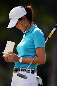 Michelle Wie checks her scorecard