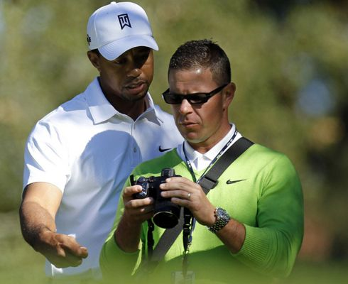 Tiger Woods and Sean Foley watching swings on camera